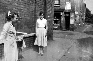 Eileen Lowe and Carol Wesley standing on Friar Street at the corner with Churchill Street in the late 1950s.