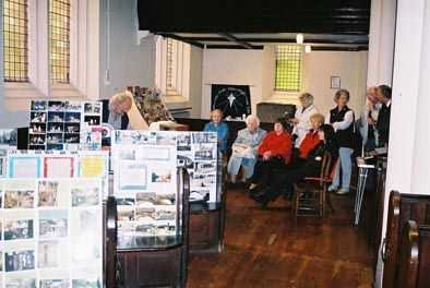 As part of the activities put on for the Lenton Festival in May 2003 the Society mounted an exhibition held in Holy Trinity Church, Lenton.  Behind the display boards on the left of the photograph Cliff Voisey can be seen showing some the Society's slides to interested participants.