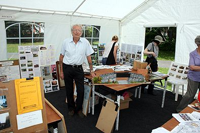Photograph taken by Paul Bexon at the Society's exhibition held as part of the Lenton Festival 13 June 2009.  Society member, Derrick Norris, poses with his model of the bridge over the Nottingham canal which once provided pedestrian access between Leengate and Spring Close.